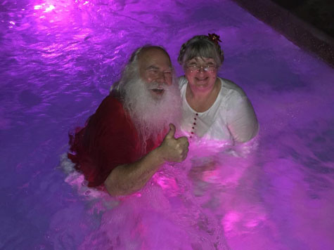 Mrs Claus and Santa in Hot tub